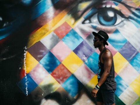 Man walking by street art