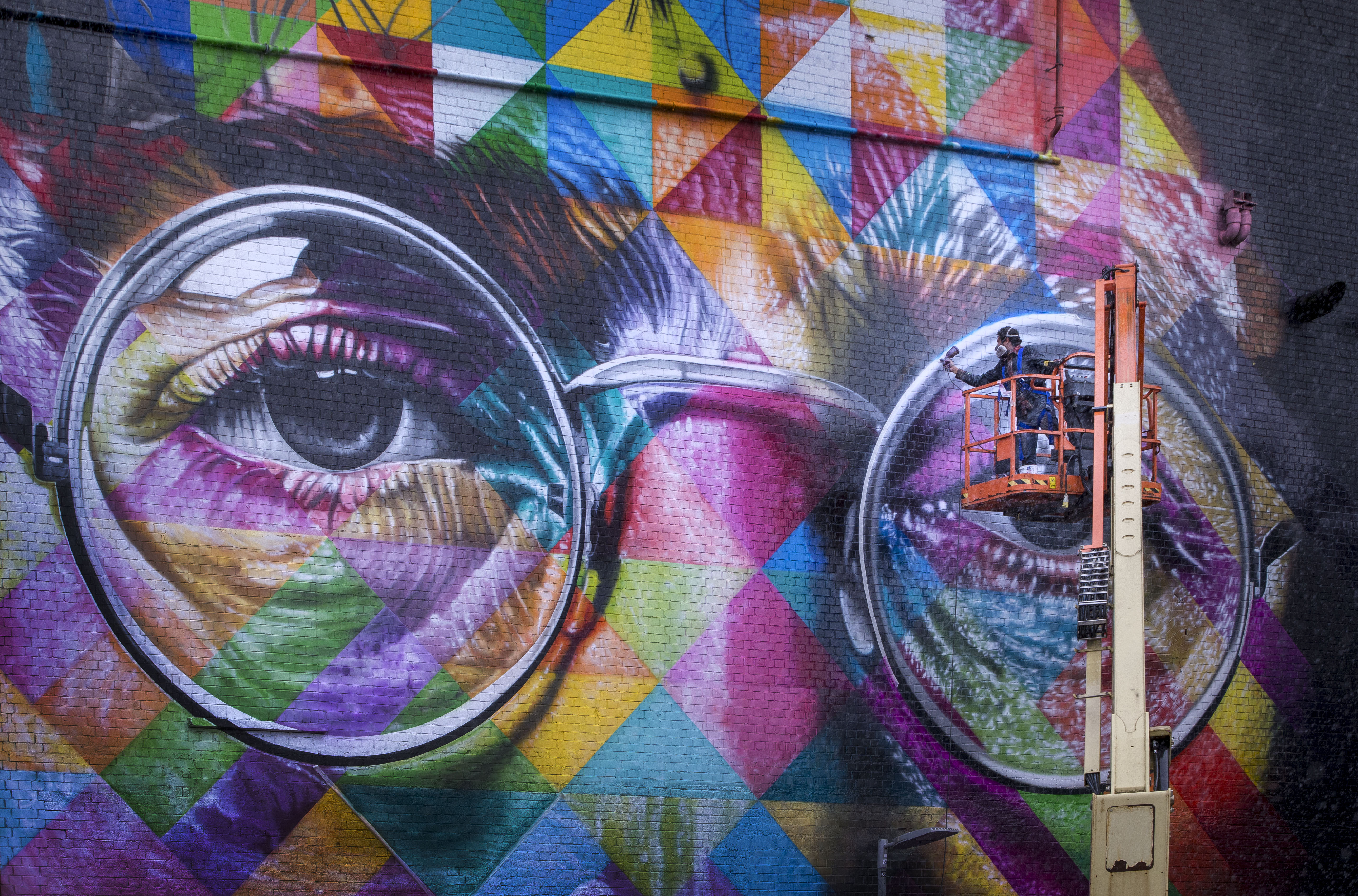 Graffiti image of man in glasses on a large wall