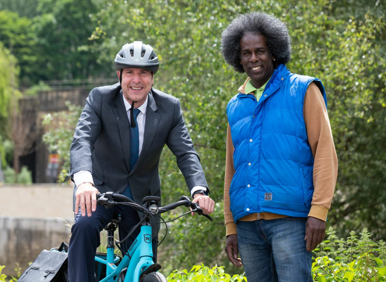 Metro Mayor Dan Norris with charity bike worker