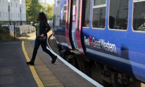 Lady getting off a train
