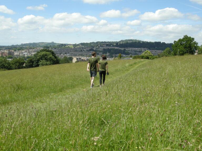 Couple walking in a field